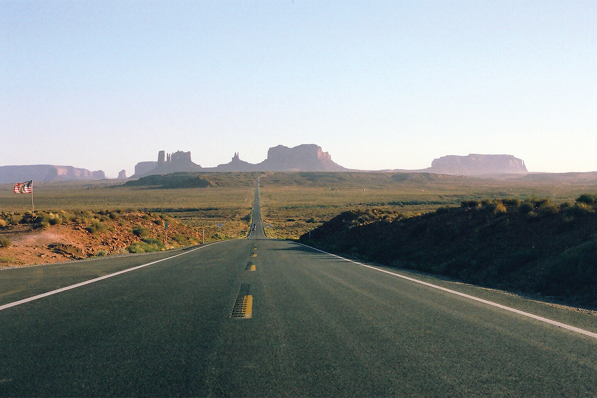 A road in front of buttes.