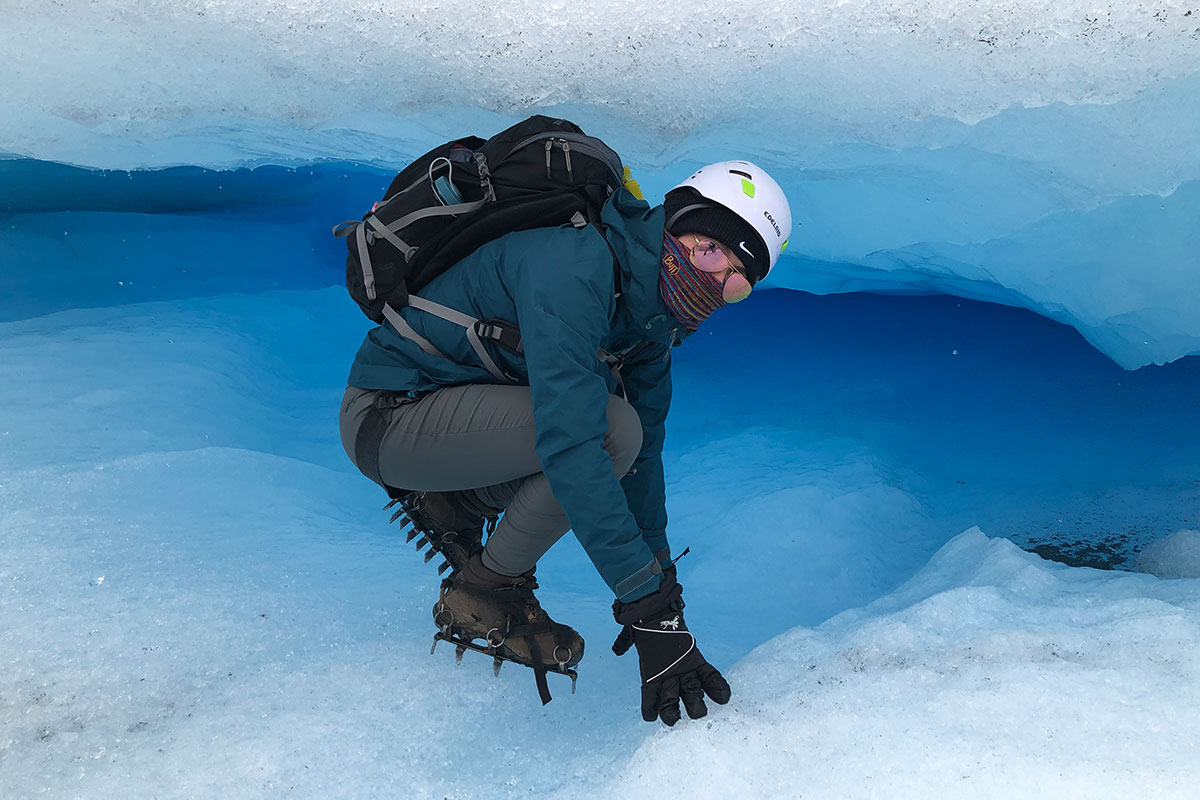 A man standing on a glacier.
