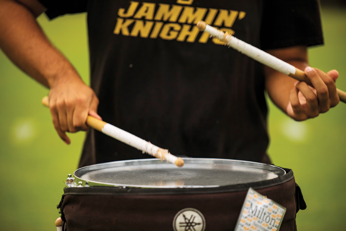 A person playing the drums.