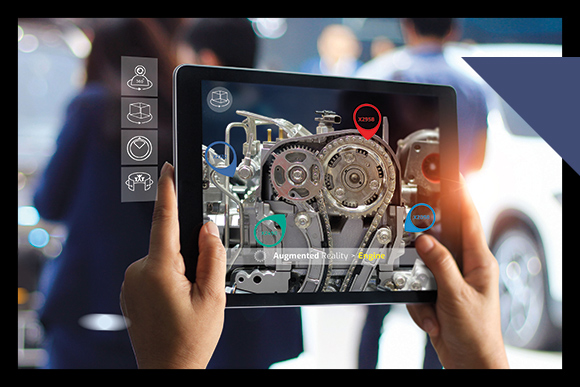 pair of hands hold ipad with image of cogs and wheels