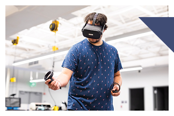 Man wearing VR headset holds control in hand