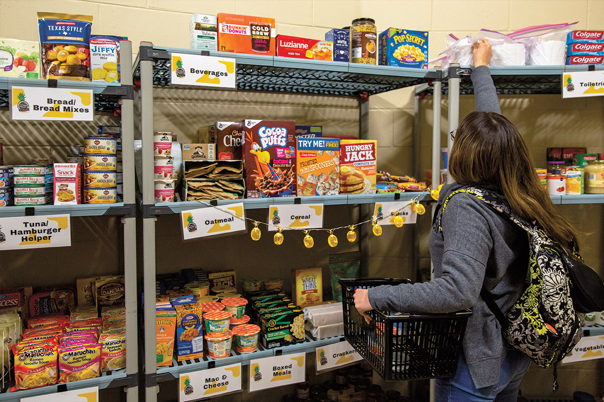 Woman browses shelves of food
