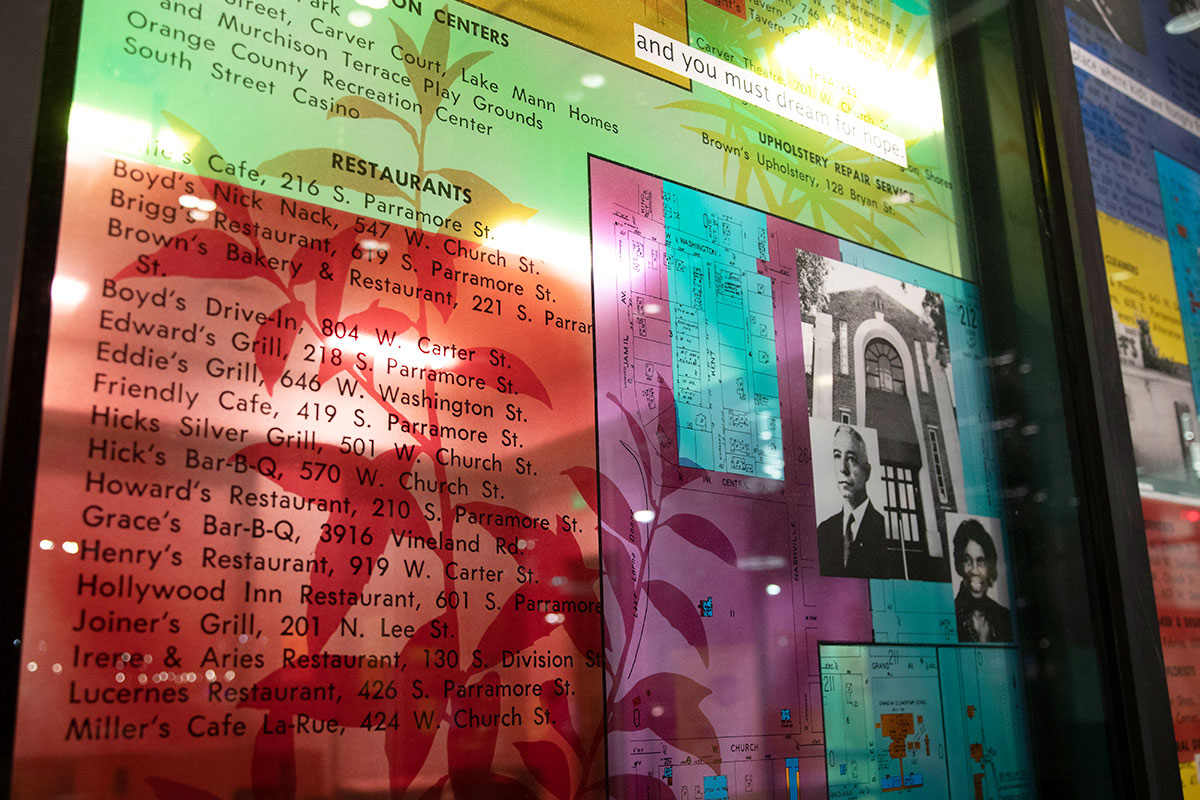 Stained glass collage listing the names and address of businesses in Parramore.
