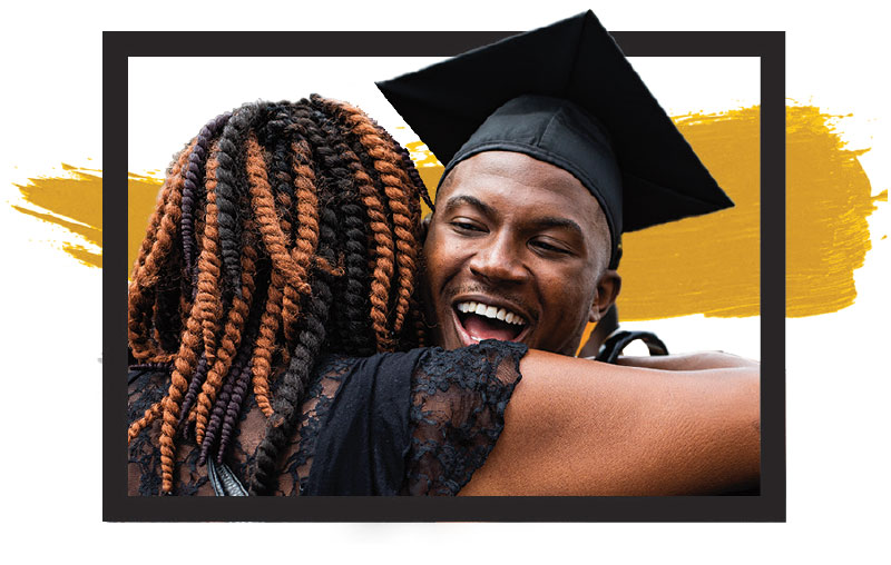 Image of a graduate hugging another person
