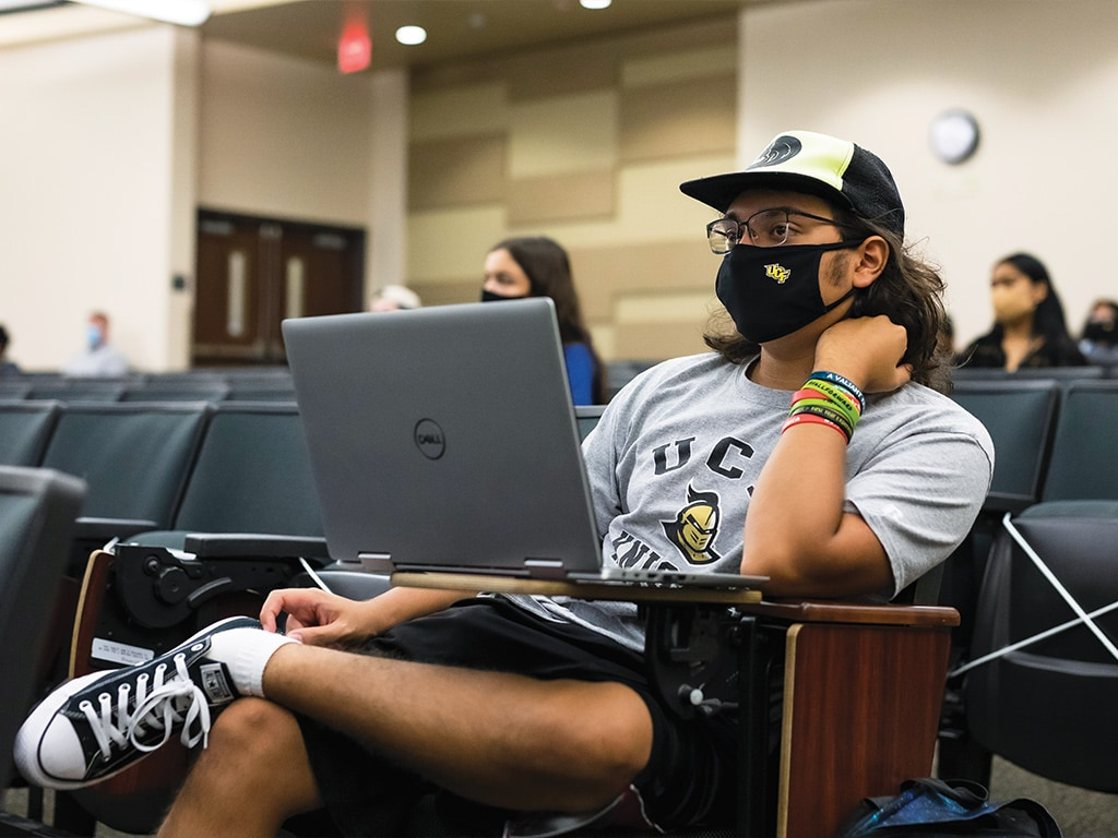 ucf student sitting in class with mask on
