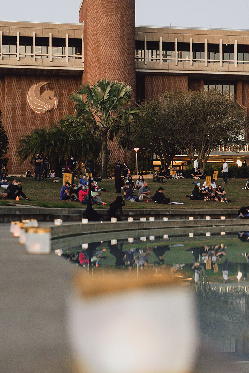 Knights sitting at the Reflecting Pond for a vigil.