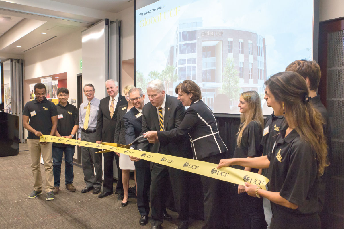 President Hitt cuts ribbon at ribbon cutting ceremony