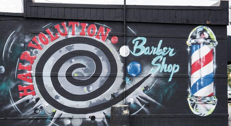 Mural on side of a barber shop