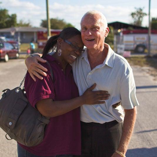 Harris Rosen and woman hugging