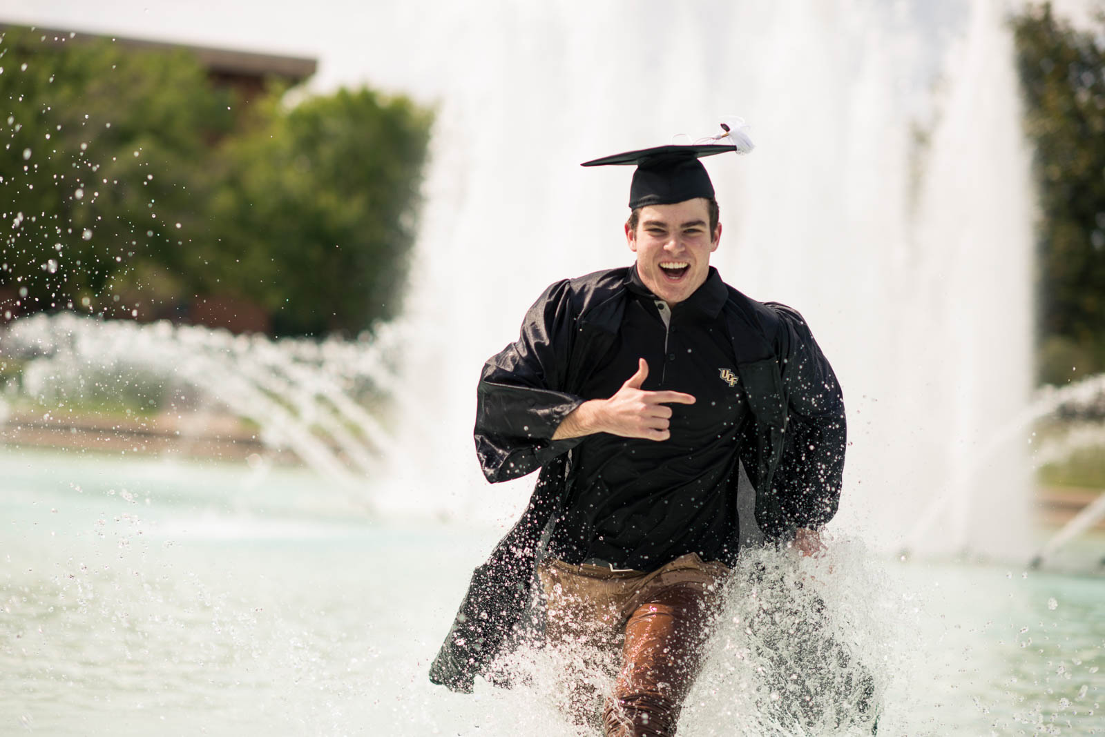 ucf-best-of-photos-graduate-running-through-reflecting-pond