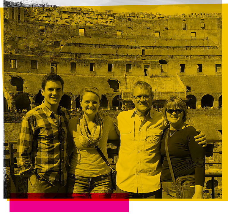 Dale Whittaker posing with his family in front of a landmark in Rome