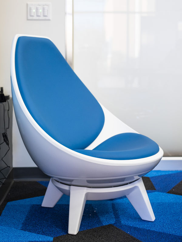 A white and black curved chair.