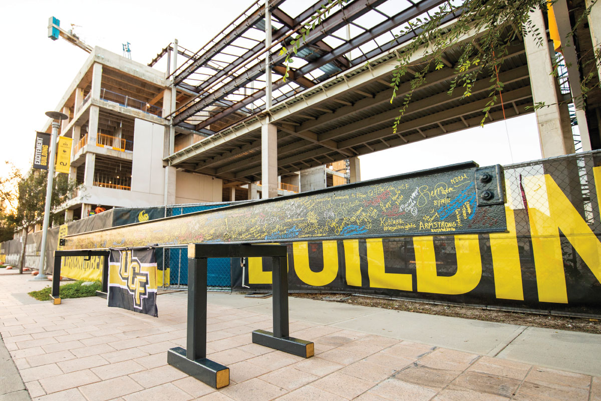 A steel beam outside the UCF Downtown campus is covered with signatures.