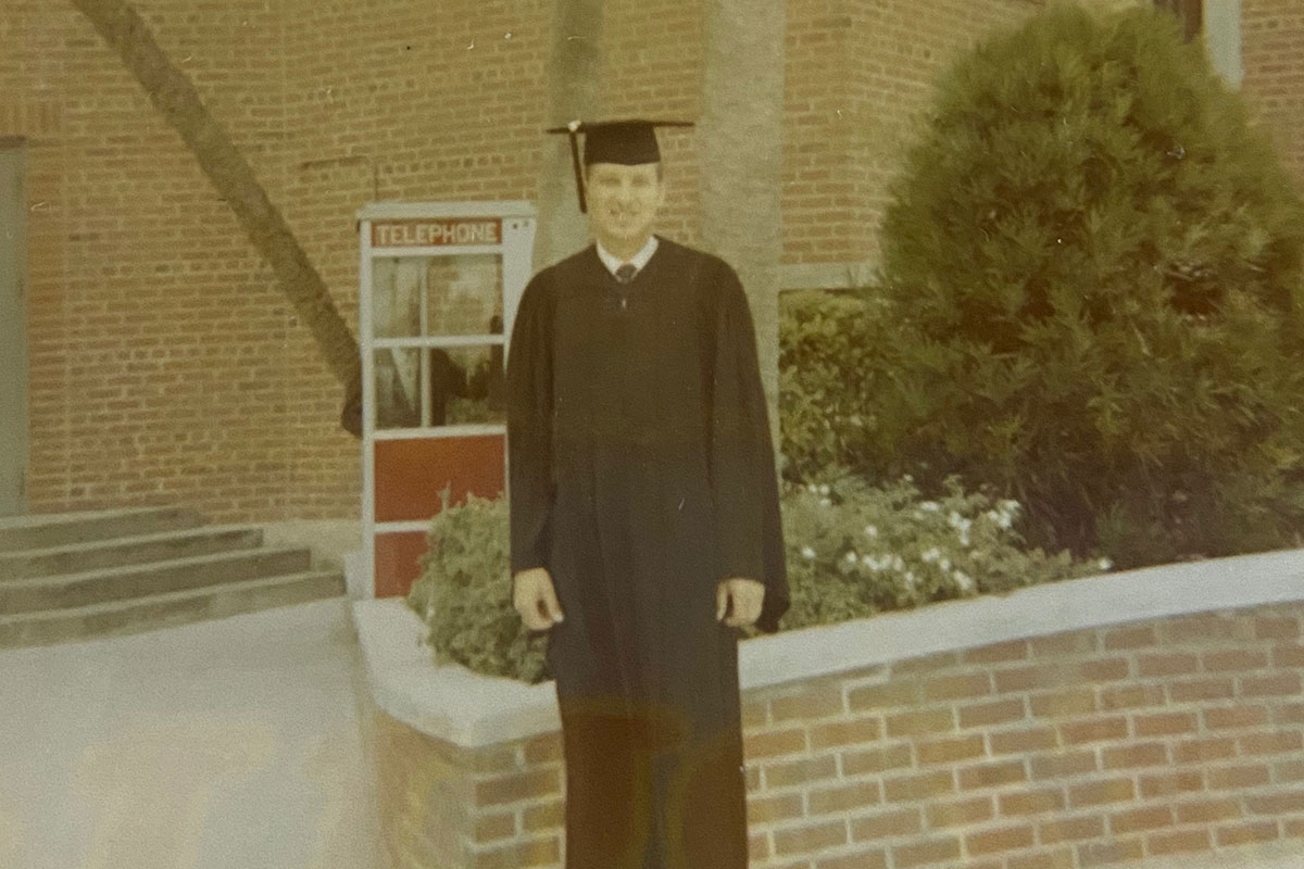 Gary Wright '70 in a grad cap and gown