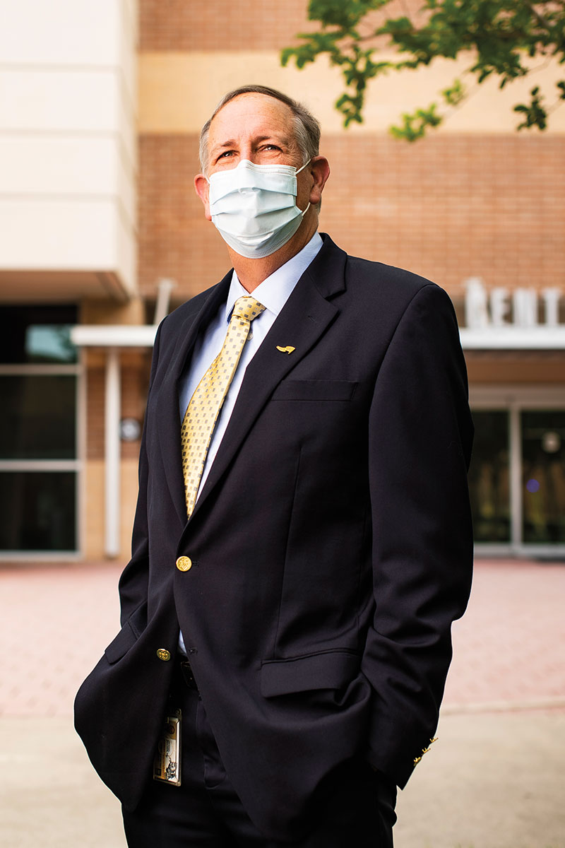 Michael Deichen wears a mask outside of UCF' Student Health Center.