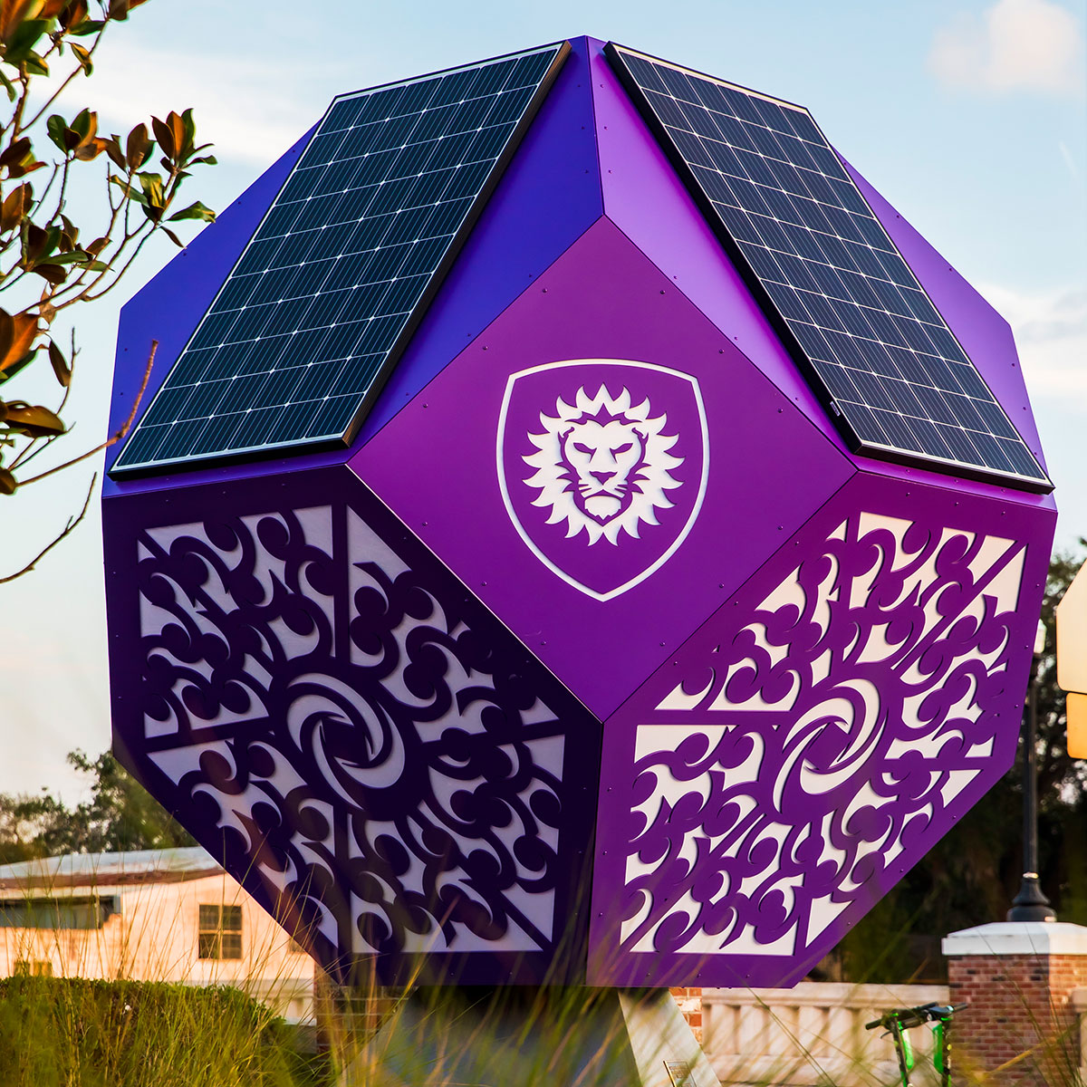 Two solar panels and intricate designs on the solar sculpture.