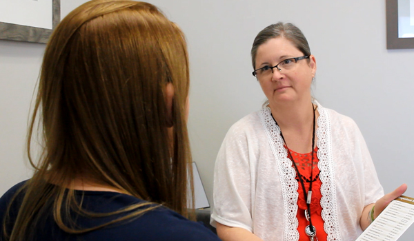 victim services talking with a student
