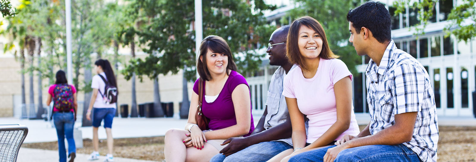 ucf students sitting on bench while chatting