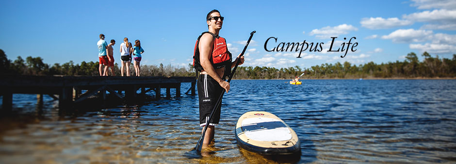 Campus Life Paddle Boarder at Lake Claire