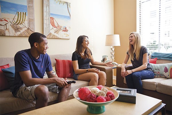 Students sitting on couches in UCF housing