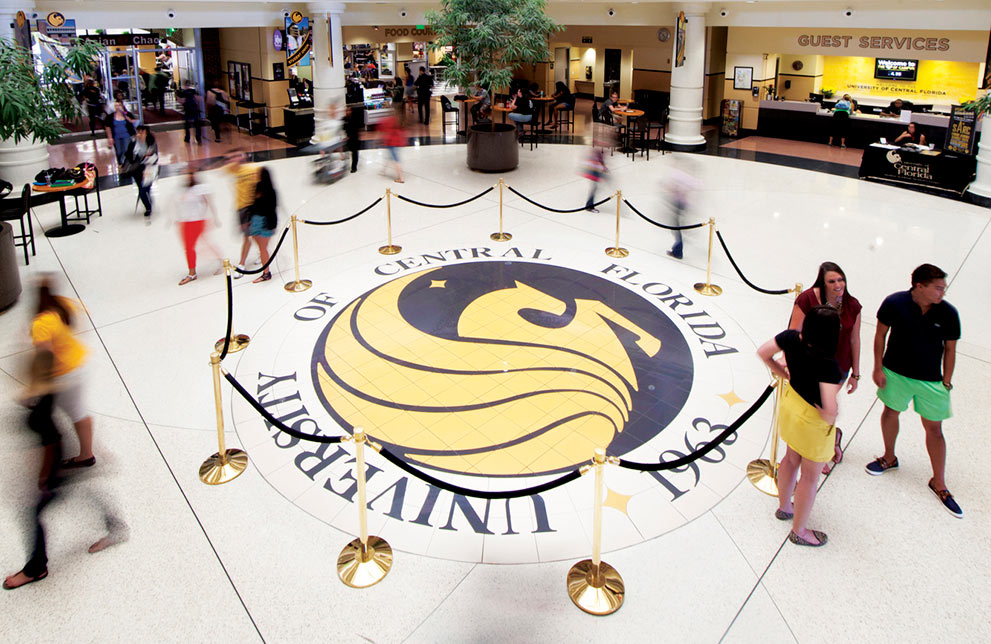 pegasus logo in ucf student union with students walking and standing around